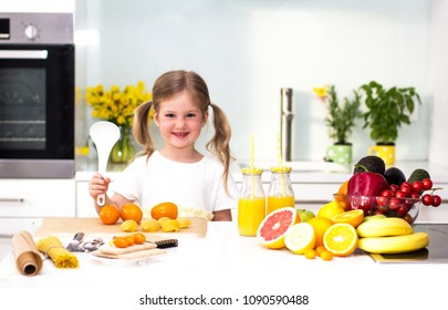 Sweet little cute girl is cooking in kitchen at home. Happiness activitiy, family concept.