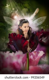 Sweet little fairy in a blossom red tulip