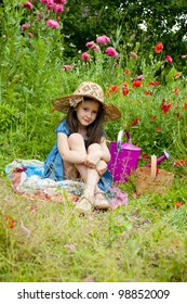 sweet little girl in the garden with wild poppies