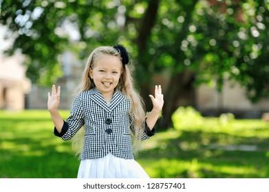 Sweet little girl having fun in a park