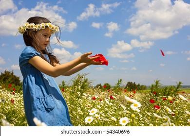 Sweet little girl on the beauty field with wild flowers