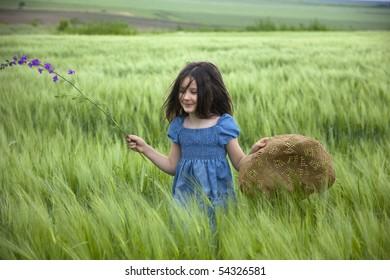 Sweet little girl on the field