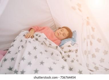 Sweet little girl is sleeping