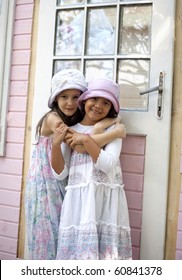 Sweet little girls in front of her little house for playtime