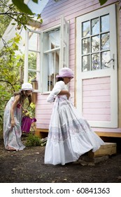 Sweet little girls in front of him little house for playtime
