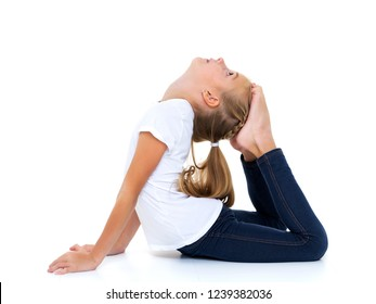 A sweet little gymnast girl performs an acrobatic element on the floor. The concept of sport, healthy lifestyle. Isolated on white background.