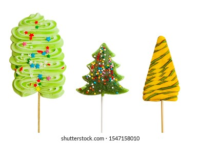 Sweet lollipop, marshmallow, made in the form of a green Christmas tree, isolated on a white background, close-up