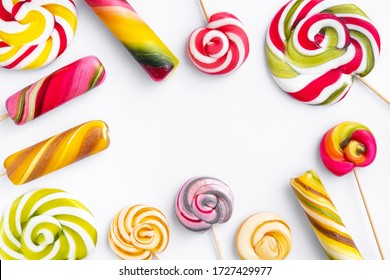 Sweet lollypops isolated on a white background. Top view. Flay Lay. Space for text.