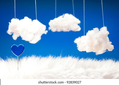 Sweet and lovely dreams - theme in blue with heart on spring, fur and cotton wool clouds