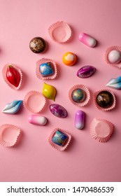 Sweet luxury chocolate bonbons from above on pink
