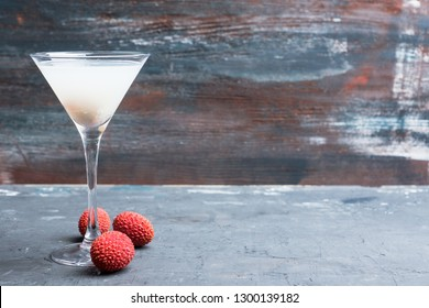 Sweet lychee martini on the rustic background. Selective focus. Shallow depth of field.