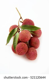 Sweet lychees fruits with leaves close up on white background