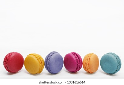 Sweet macarons cakes in light background.