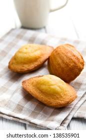 sweet madeleine cookies on table
