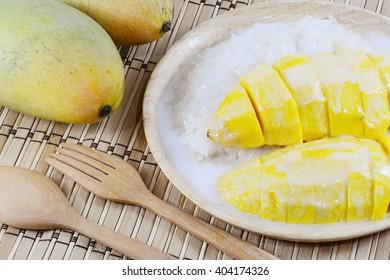 Sweet mango with sticky rice mix with coconut milk