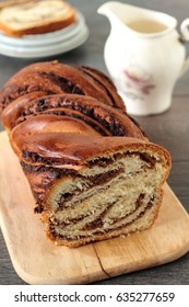 Sweet marbled brioche plait with nuts and chocolate