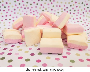 Sweet Marshmallows in Front of pointed background