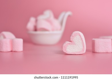 Sweet marshmallows in the shape of heart in the ceramic cup with pink pastel background. Concept about love and relationship. Romantic Style, Creative for colorful greeting card.Copy space for text