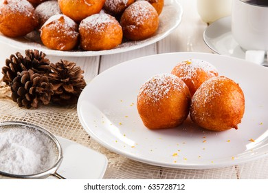 Sweet mini donuts - breakfast with coffee on white table