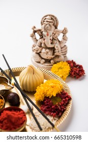 Sweet Modak food and Pooja Thali arranged for worshipping Lord Ganesh , Selective focus