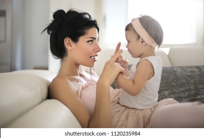 Sweet mom talking to her beautiful daughter