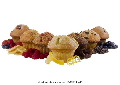 Sweet muffins and ingredients on white background.