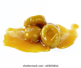 Sweet natural caramel syrup on a white background