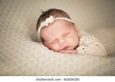 Sweet newborn baby sleeping in a bed.