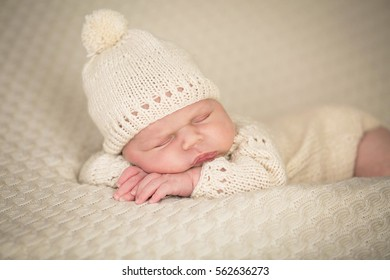 sweet newborn baby sleeping in a bed