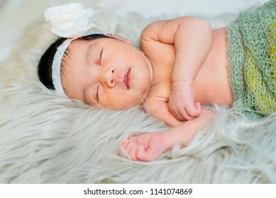 sweet newborn baby sleeping in the fur