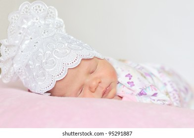 sweet newborn girl dreaming at home