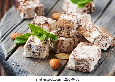 Sweet nougat with chocolate and almonds, selective focus