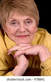 Sweet older woman wearing yellow raincoat