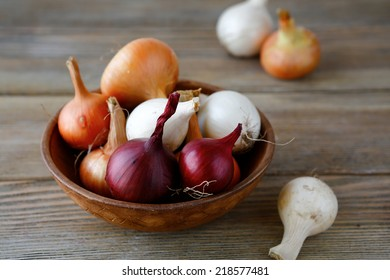 Sweet onions on wooden background. Raw food