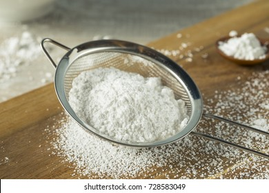 Sweet Organaic Confectioners Powdered Sugar in a Sieve