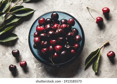 Sweet organic berries on a light concrete background. Top view with copy space.
