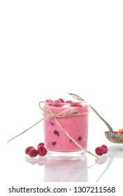 sweet organic smoothie with raspberry on wooden
