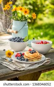 Sweet pancakes for breakfast in sunny garden