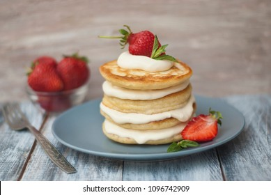 Sweet Pancakes with Cream and Strawbery. Health Breakfast Fruit Berry Vitamine Gray Rustic Wooden Background