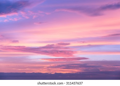 Sweet pastel pink and purple color of sunset sky as vintage background