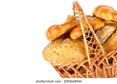 Sweet pastries, bread and flour products in a wicker basket isolated on white background.Free space for text. Healthy food.