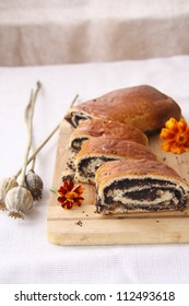 Sweet pastries with poppy seeds, nuts and raisins