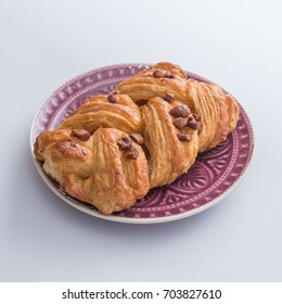 Sweet pastry with nuts isolated on white.