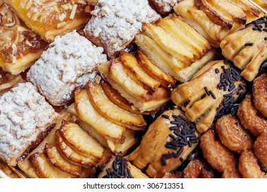 Sweet pastry, puff pastry with powdered sugar, with pine nuts,  with jam made from Siam pumpkin, puff pastry with roasted apples and  with baked apples.