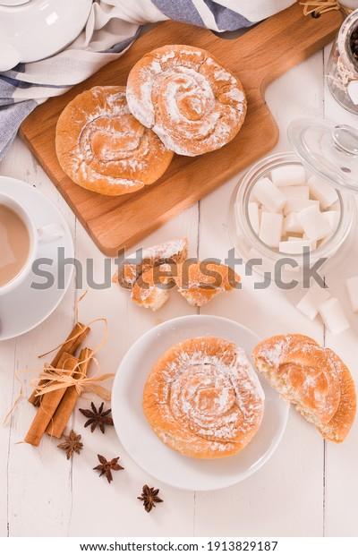 sweet-pastry-swirls-icing-sugar-600w-191