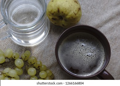 Sweet pear, water, green grapes. All organic and fresh. Cup with kvass.