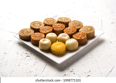 sweet Peda / Pedha in different flavours and colour. Served in a bowl or plate. It's a popular festival food from India. selective focus