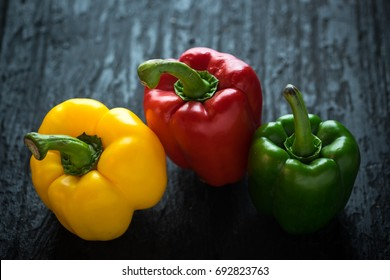 Sweet pepper on dark wooden table