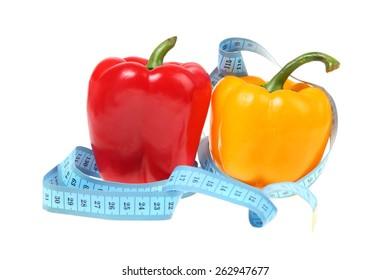 Sweet peppers with a blue measuring tape.