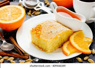 Sweet pie Basbousa (Namoora) with orange cardamom coconut semolina selective focus